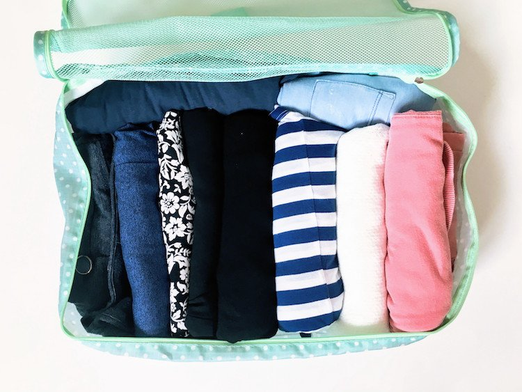 Packing cube with organized clothes
