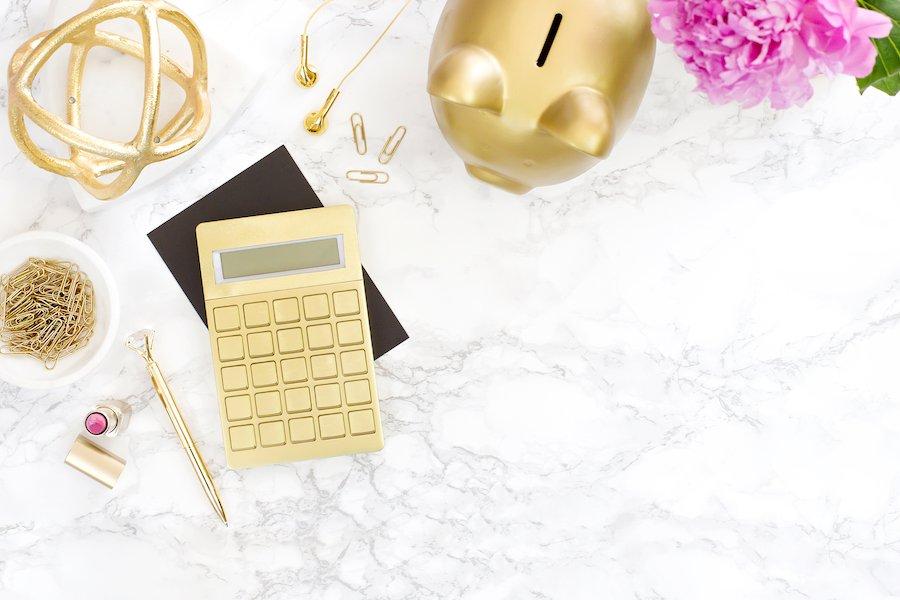 Gold Piggy Bank and Calculator