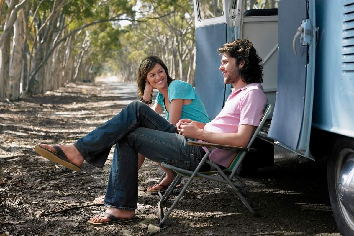 Couple living in camper sitting on roadside